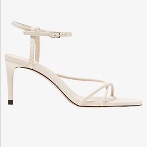 Heeled sandals with tubular straps. NEW